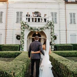Giant floral garland over doorway - wedding decor